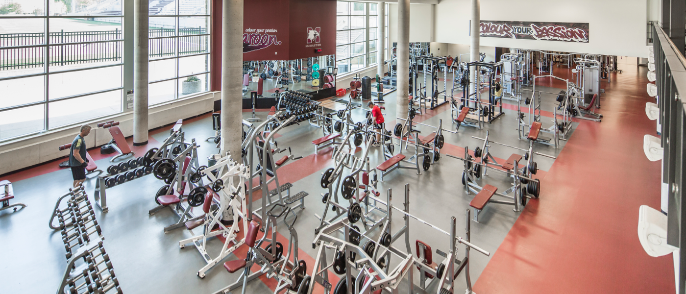 Pulse Fitness Centre - McMaster gym facility with training benches, barbell sets and other workout equipment