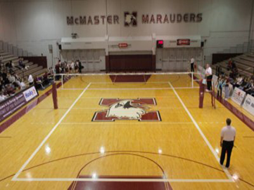 Large McMaster Gym with McMaster Marauders logo in the centre and volleyball net
