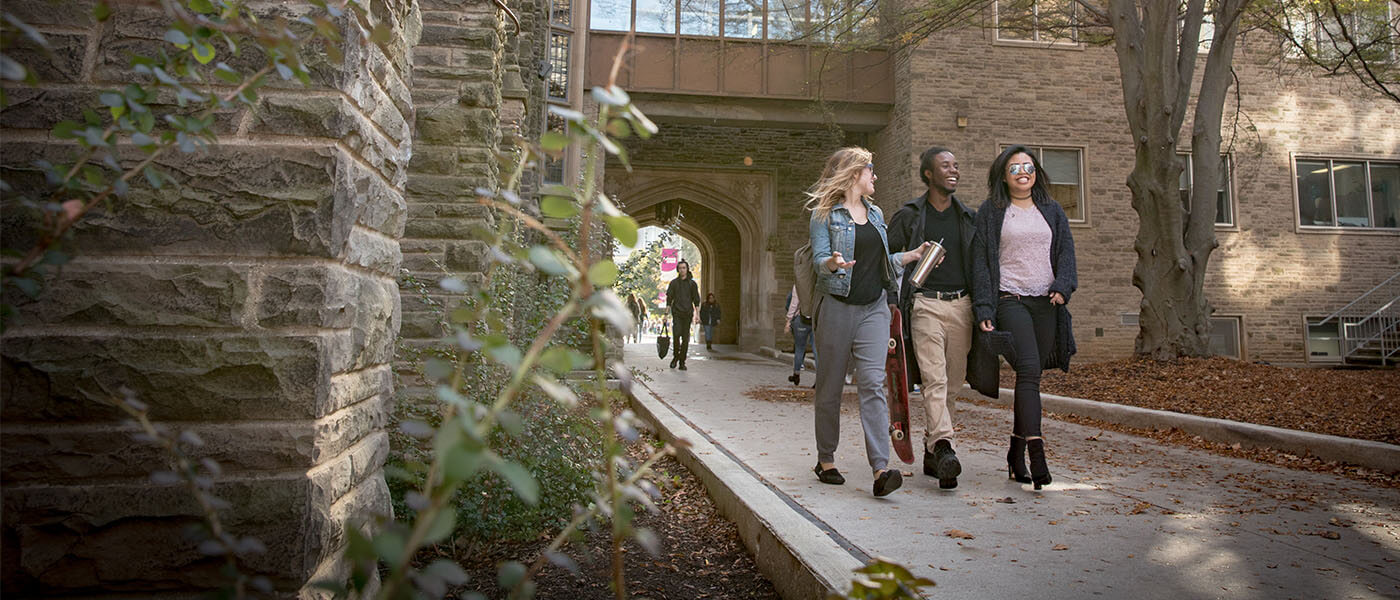 Three McMaster students walking through McMaster campus