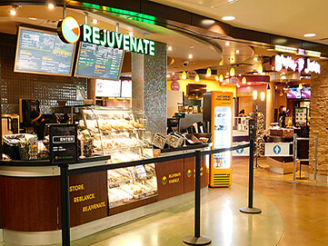 Coffee stand with baked goods, light fare, and refreshments