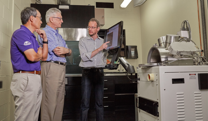 3 Scientists in science lab with high-tech equiptment