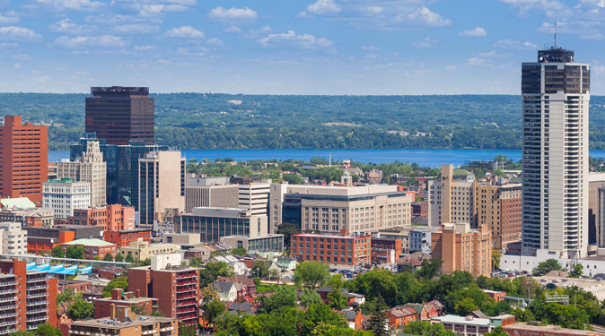 View of the city of Hamilton with lake and greenery in background