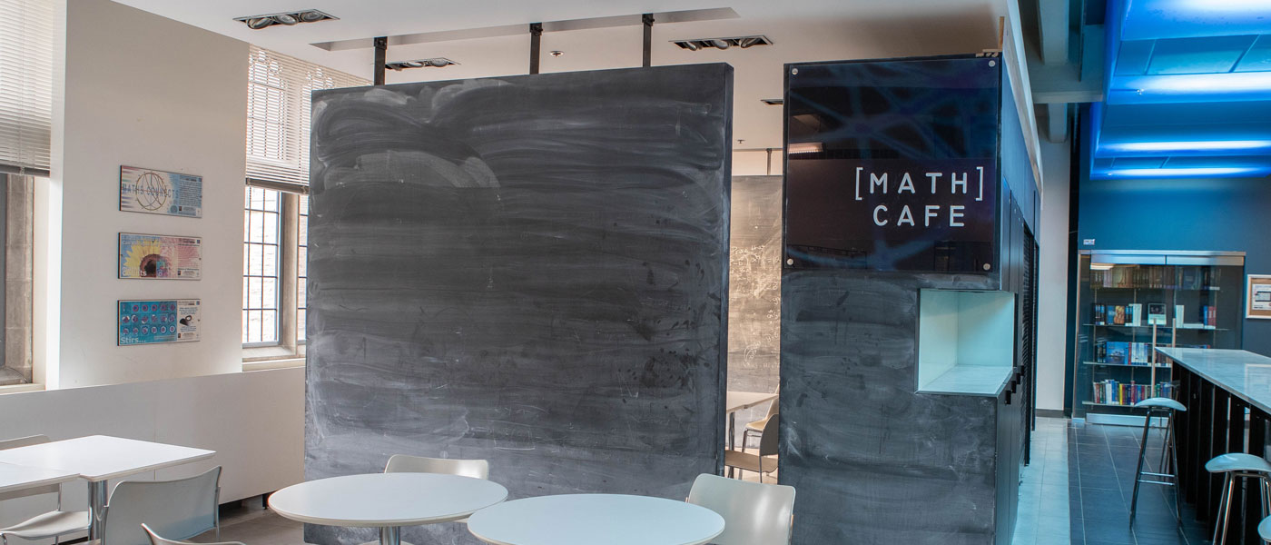 Cafe with a blackboard, tables and chairs