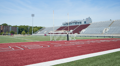 Play at McMaster - McMaster Ron Joyce Stadium - McMaster football field surrounded by stadium bleachers
