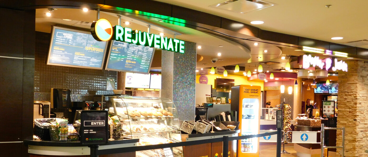 Rejuvenate - Take-out counter with glass display of baked goods