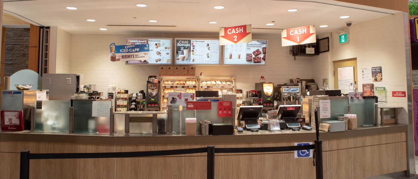 Bright Tim Hortons order counter with baked goods display